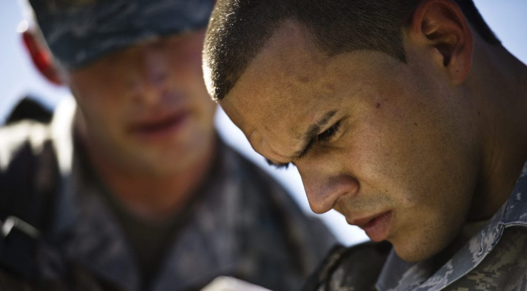 Tech. Sgt. Jarod Bomberger watches while Senior Airman Daniel West plots their course on the map Oct. 26, 2010, at Camp Bullis, Texas. Sergeant Bomberger and Airman West are going through land-navigation training and must successfully use a map, compass, and a protractor to reach several points more than 1,000 meters apart. Land navigation is one of many subjects covered in the Combat Leadership Course. (U.S Photo/Staff Sgt. Jonathan Snyder)
