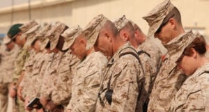 Marines and sailors bow their heads during the chaplain's invocation at Marine Wing Support Squadron 373's transfer of authority to MWSS-272 at Camp Leatherneck, Afghanistan, March 27. The transfer of authority ceremony not only symbolized the end of MWSS-373's operational responsibilities in support of Regional Command Southwest, but served as a beginning to MWSS-272's commitment in support of 2nd Marine Aircraft Wing (Forward) and its coalition partners in Afghanistan.