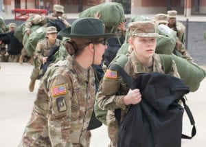 "A U.S. Army drill sergeant corrects a recruit during her first day of training at Fort Leonard Wood, Mo., Jan. 31, 2017. Referred to as ""Day Zero"" this marks the beginning of the recruit's journey through Basic Combat Training, where she will transition from a civilian to a Soldier."