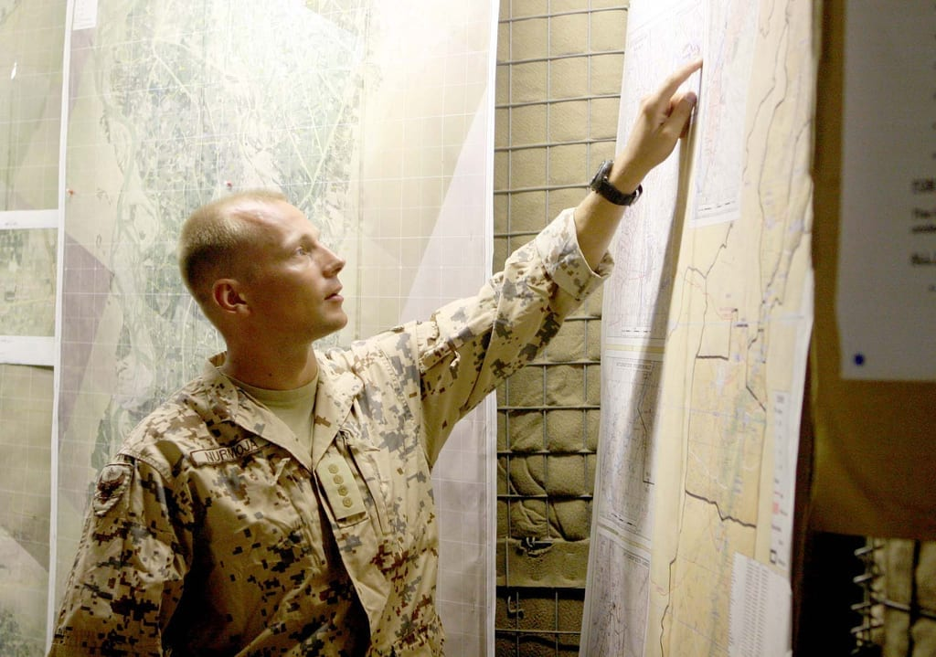 Estonian Capt. Villiko Nurmoja, liasion officer with the Estonian Army, points at a map of the province Sept. 22, 2009, during a brief of the area to discuss future operations in the area. Photo by U. S. Marine Corps