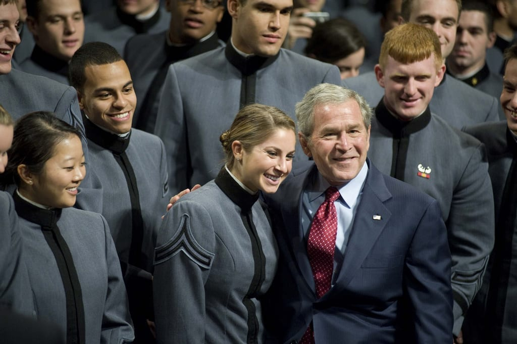 President George W. Bush takes a photo opportunity with a cadet at Eisenhower Hall following his address to the Corps of Cadets Tuesday.