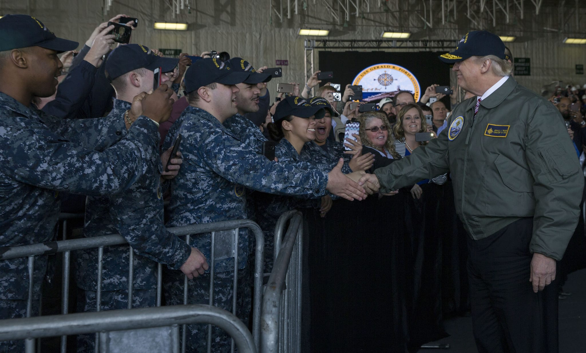 NEWPORT NEWS, Va. (March 2, 2017) President Donald J. Trump greets Sailors after entering the hangar bay aboard Pre-Commissioning Unit Gerald R. Ford (CVN 78). Trump visited March 2 to meet with Sailors and shipbuilders of the Navy's first-in-class aircraft carrier during an all-hands call inside the ship's hangar bay. (U.S. Navy photo by Mass Communication Specialist 3rd Class Cathrine Mae O. Campbell/Released)170302-N-ZE240-0292