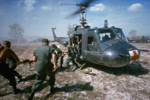ca. 1968, south of Dunang, Vietnam --- A helicopter airlifts wounded victims of a booby trap explosion. Such resues were known as dust-offs. --- Image by © Tim Page/CORBIS