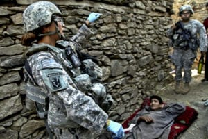 A U.S. Army sergeant, left, with 1st Battalion, 102nd Infantry Regiment, 86th Brigade Combat Team, Task Force Iron Gray prepares to treat injured people in Masamute Bala in Laghman province, Afghanistan, as the village is condoned and searched Sept. 25, 2010. (U.S. Army photo by Spc. David A. Jackson/Released)