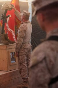 Sgt. Maj. Bryan Zickefoose, the sergeant major of Regimental Combat Team 1, pays respects to 1st Lt. James Zimmerman, formerly the commander of 3rd Platoon, Echo Company, 2nd Battalion, 6th Marine Regiment, during Zimmerman's memorial service at Patrol Base Shanfield, Helmand province, Afghanistan, Nov. 11. Zimmerman was from Aroostock, Maine.