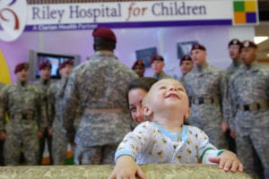 090821-A-5406P-010 Eleven-month-old Dylan grooves to the music while listening to a performance by Paratroopers from the 82nd Airborne Division Chorus at the Riley Hospital for Children in Indianapolis, Ind. Aug. 21. The chorus performed songs and visited sick children at two area children's hospitals while in town for the 82nd Airborne Division Association Convention held in Indianapolis Aug. 19-22. (U.S. Army photo by Staff Sgt. Mike Pryor, 2nd BCT, 82nd Abn. Div. Public Affairs)