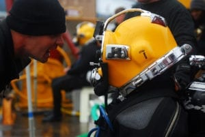 Staff Sgt. Joshua West, diving supervisor, 7th Diving Team, confirms that Sgt. Jake Cochran, lead diver, 7th Diving Team, is ready for his dive.