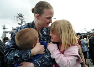 110319-N-YB753-170<br /> SAN DIEGO (March 19, 2011) Mass Communication Specialist 1st Class Sarah Murphy embraces her children upon return from a deployment aboard the aircraft carrier USS Abraham Lincoln (CVN 72). The Abraham Lincoln Carrier Strike Group stopped in San Diego on its way home to Everett, Wash., following more than six months deployed in the U.S. 5th and 7th Fleet areas of responsibility supporting maritime security operations and theater security cooperation efforts. (U.S. Navy photo by Mass Communication Specialist 2nd Class Brian Morales/Released)
