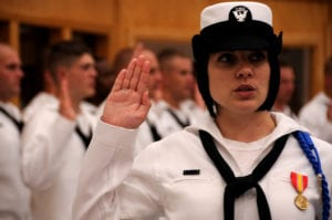 110728-N-XT989-002<br /> GREAT LAKES, Ill. (July 28, 2011) Hospital Corpsman Apprentice Marisa Pinelli, from Orlando, Fla., recites the Hospital Corps Pledge during the Naval Hospital Corps School Great Lakes disestablishment ceremony. After nearly a century of training hospital corpsmen, the school is disestablished as part of a Base Realignment and Closure (BRAC) initiative which ultimately consolidated enlisted medical training at the Medical Education Training Campus at Fort Sam Houston, Texas. (U.S. Navy photo by Electronics Technician 3rd Class Trisha Teran/Released)