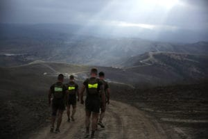 Marines assigned 1st Marine Division, run along hills during the Dark Horse Ajax Challenge aboard Marine Corps Base Camp Pendleton, California, Aug. 20, 2015. The eight-mile course tested the Marines' and Sailors' endurance and leadership skills with trials spread across the San Mateo area.<br /> (U.S. Marine Corps photo by Cpl. Will Perkins/Released)