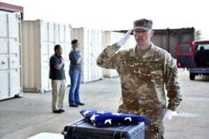 U.S. Army Staff Sgt. Richard Walton, assistant operations noncommissioned officer, Indo-Pacific directorate, Defense POW/MIA Accounting Agency (DPAA), renders honors during an honorable carry for the possible remains of unidentified U.S. service members lost during the Vietnam War at Joint Base Pearl Harbor-Hickam, Hawaii, Mar. 31, 2019. The remains were recently received through a unilateral transfer from the Kingdom of Cambodia as part of DPAA's efforts to provide the fullest possible accounting of our missing personnel to their families and the nation. (U.S. Army photo by Staff Sgt. Jamarius Fortson)