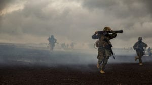 U.S. Marines with Weapons Company, 3rd Battalion, 3rd Marine Regiment maneuver from a chemically gassed area during Exercise Bougainville II at the Pohakuloa Training Area, Island of Hawaii, Oct. 20, 2018. Exercise Bougainville II is the 2nd part of the pre-deployment workup focusing on platoon and company level exercises. (U.S. Marine Corps photo by Sgt. Ricky Gomez)