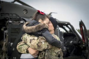 U.S. Army Chief Warrant Officer 3 Austin Randolph hugs his daughter Elliana before taking off for a deployment in support of Operation Freedom's Sentinel in Afghanistan on Joint Base McGuire-Dix-Lakehurst, N.J., Jan. 3, 2019. Randolph is a UH-60L Black Hawk helicopter pilot with the New Jersey National Guard's Det. 2, Charlie Company, 1-171st General Support Aviation Battalion (MEDEVAC). (U.S. Air National Guard photo by Master Sgt. Matt Hecht)