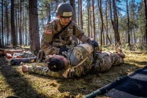 Spc. William Horne, combat medic, assigned to 1st Infantry Division treats and evacuates simulated casualties during U.S. Army Europe Expert Field Medical Badge Combat Testing Lane 3 at Grafenwoehr Training Area, Germany, March 29, 2019. To qualify for the EFMB, Soldiers must endure a multitude of events such as land navigation, physical fitness test, medical evacuations, weapons function checks, ruck march, chemical biological radioactive nuclear evaluations, written test, and medical treatments. (U.S. Army photo by Maj. Robert Fellingham, 30th Medical Brigade)