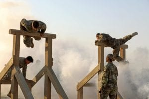 """Soldiers from 1st Battalion, 8th Infantry Regiment, 3rd Armored Brigade Combat Team, 4th Infantry Division, complete the """"Gut Buster"""" obstacle at the Camp Buehring, Kuwait Air Assault obstacle course on Thursday, June 6, 2019. The Soldiers, currently deployed in support of Operation Spartan Shield, completed the course in small teams in memory of the 1-8 Soldiers who landed on Utah Beach as part of the D-Day invasion of Normandy. U.S. Army photo by Sgt. Liane Hatch"""