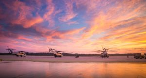 Three CH-53E Super Stallion's with Marine Heavy Helicopter Squadron (HMH) 461, are stationary on the flight line in Brunswick, Maine, July 17, 2019. The purpose of HMH-461's deployment for training is to increase the squadron's proficiency in mountainous terrain operations, to conduct mission essential tasks in a challenging environment, and improve combat readiness. (U.S. Marine Corps photo by Cpl. Micha Pierce)