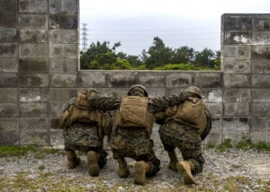U.S. Marines assigned to Headquarters Battery, 12th Marine Regiment, 3rd Marine Division, practice throwing grenades at Camp Hansen in Okinawa, Japan, Feb. 26, 2020. The Marines were participating in a grenade range in order to maintain their knowledge and lethality with M67 grenades. (U.S. Marine Corps photo by Cpl. Savannah Mesimer)