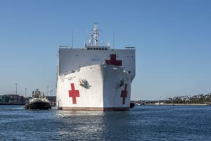 LOS ANGELES (March 27, 2020) The Military Sealift Command hospital ship USNS Mercy (T-AH 19) arrives in Los Angeles, March 27, 2020. Mercy deployed in support of the nation's COVID-19 response efforts, and will serve as a referral hospital for non-COVID-19 patients currently admitted to shore-based hospitals. This allows shore base hospitals to focus their efforts on COVID-19 cases. One of the Department of Defense's missions is Defense Support of Civil Authorities. DoD is supporting the Federal Emergency Management Agency, the lead federal agency, as well as state, local and public health authorities in helping protect the health and safety of the American people. (U.S. Navy photo by Mass Communication Specialist 1st Class David Mora Jr./Released) 200327-N-UV609-1043