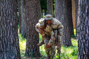 Pfc.Lookadoo Daniel, Palatka , Florida native, automated logistical specialist with1st Squadron, 2nd Cavalry Regiment, carries another Soldier to safety to provide medical care during combat lifesaver training with Battle Group Poland at Bemowo Piskie Training Area, Poland,May 31, 2018. Battle Group Poland is a unique, multinational coalition of U.S., U.K., Croatian and Romanian Soldiers who serve with the Polish 15th Mechanized Brigade as a deterrence force in support of NATO's Enhanced Forward Presence. (U.S. Army photo by Spc. Hubert D. Delany III)