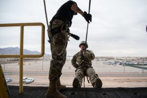 Army Cpl. Alexandra Perez, Iron Training Detachment air assault instructor, instructs Air Force Staff Sgt. James Tienor, 377th Security Forces Group Air Assault trainee, on proper rappelling techniques at Fort Bliss, Texas, March 8, 2019. Nine members of the 377th SFG at Kirtland Air Force Base, N.M., graduated from the Fort Bliss Air Assault Training School March 11, 2019. (U.S. Air Force photo by Staff Sgt. J.D. Strong II)