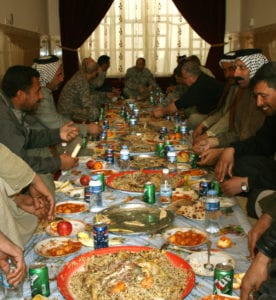 Warhorse Soldiers and Diwaniya sheiks break bread together and discuss local issues in an assessment of a district of the province on Dec. 14.