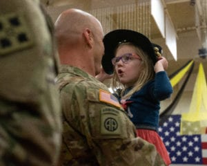 "Lt. Col. Jamie LaValley, assigned to the 4th Combat Aviation Brigade, 4th Infantry Division, reunites with his daughter Mira, following a homecoming ceremony held at the William ""Bill"" Reed Center, Fort Carson, Colorado, March 8, 2019. The 4th CAB deployed to Europe as part of the regionally allocated forces supporting Operation Atlantic Resolve, an important mission for strengthening relationships and interoperability amongst Allies and partners while demonstrating our collective security capability. (U.S Army photo by Spc. Robert Vicens)"