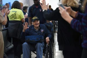 World War II Army veteran David Friedrich arrives to a hero's welcome at Reagan National Airport, Arlington, Va., Dec. 6, 2018. Friedrich was part of a special Honor Flight from Austin, Texas, that brought World War II veterans to the nation's capital for the 77th anniversary of Pearl Harbor. (DoD photo by Lisa Ferdinando)