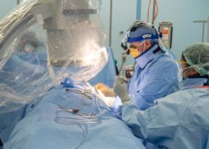 LOS ANGELES (April 29, 2020) Cmdr. Andrew Kaplan, a cardiac electrophysiologist from Phoenix, sutures a patient aboard the hospital ship USNS Mercy (T-AH 19), April 29, 2020. Mercy deployed in support of the nation's COVID-19 response efforts, and serves as a referral hospital for non-COVID-19 patients currently admitted to shore-based hospitals. This allows shore base hospitals to focus their efforts on COVID-19 cases. One of the Department of Defense's missions is Defense Support of Civil Authorities. DoD is supporting the Federal Emergency Management Agency, the lead federal agency, as well as state, local and public health authorities in helping protect the health and safety of the American people. (U.S. Navy photo by Mass Communication Specialist 3rd Class Jake Greenberg/Released)200429-N-DA693-1194