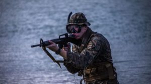 A U.S. Marine with Bravo Company, 1st Battalion, 3rd Marine Regiment, scans his surroundings during an amphibious assault exercise on Marine Corps Base Hawaii, April 28, 2020. Bravo Company conducted the boating event to increase proficiency in areas that are uncommon to infantry training within the Marine Corps while mitigating risks brought on by COVID-19. (U.S. Marine Corps video by Lance Cpl. Jacob Wilson)