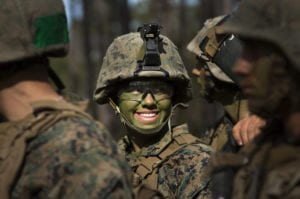 Pfc. Christina Fuentes Montenegro and other Marines from Delta Company, Infantry Training Battalion , School of Infantry-East, receive final instructions prior to assaulting an objective during the Infantry Integrated Field Training Exercise aboard Camp Geiger, N.C., Nov 15, 2013. Montenegro is one of three female Marines to be the first women to graduate infantry training with the battalion. Delta Company is the first company at ITB with female students as part of a measured, deliberate and responsible collection of data on the performance of female Marines when executing existing infantry tasks and training events, the Marine Corps is soliciting entry-level female Marine volunteers to attend the eight week basic infantryman and infantry rifleman training courses at ITB. (U. S. Marine Corps photo by CWO2 Paul S. Mancuso/Released)