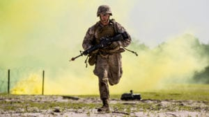 Lance Cpl. Alex Rowan, a combat engineer with 4th Marine Division, runs to take cover before the Anti-Personnel Obstacle Breaching System detonates during the SAPPER Leaders Course aboard Camp Lejeune, North Carolina, June 26, 2015. During the course, the Marines used assault and breaching techniques to clear a wire obstacle using line charges that utilized C4 explosives and their APOBS.<br /> (U.S. Marine Corps photo by Cpl. Krista James/Released)