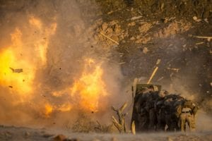 180708-M-IZ659-0304 CAMP TITIN, Jordan (July 8, 2018) U.S. Marines assigned to Combat Logistics Battalion-26 (CLB-26), 26th Marine Expeditionary Unit (MEU), take cover from demolitions during sustainment training at Camp Titin, Jordan, July 8, 2018. Iwo Jima is the flagship for the Iwo Jima Amphibious Ready Group and, with the embarked 26th Marine Expeditionary Unit, is deployed to the U.S. 5th Fleet area of operations in support of naval operations to ensure maritime stability and security in the Central region, connecting the Mediterranean and the Pacific through the western Indian Ocean and three strategic choke points. (U.S. Marine Corps photo by Cpl. Santino D. Martinez/Released)