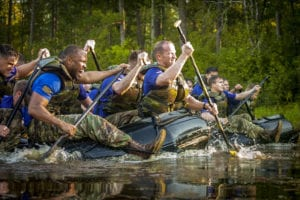 Paratroopers from Company A, forefront, and Company B, rear, compete against each other during the 307th Airborne Engineer Battalion's commemoration of the 74th anniversary of the Waal River Crossing on Wednesday, October 3, 2018 on Fort Bragg's McKellar's Pond. The paratroopers were competing to cross the lake five times in honor of Pfc. Willard Jenkins, killed by enemy fire while manning a rudder during the WWII river assault.