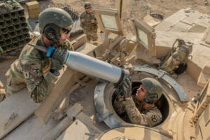 Armor crewmen assigned to Task Force Raider load Sabot rounds onto a M1 Abram Tank during a pre-deployment training exercise at Fort Hood, Texas, August 18. Sabot rounds work like a basic arrow by penetrating armor with momentum of force rather than explosive power. (Photo by U.S. Army Sgt. Sarah Kirby)