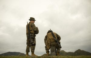 Marines await their turn to shoot the table two portion of their annual rifle range qualification, Jan. 12, 2017, at Camp Hansen, Okinawa, Japan. The Marine Corps revised table two of the marksmanship program October 2016 to increase marksmanship skill and realism in a combat environment. The Corps requires Marines to annually qualify at the range to determine their marksmanship skill. (U.S. Marine Corps photo by Lance Cpl. Andy Martinez)