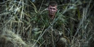 U.S. Marine Lance Cpl. William Pearn, a Shohola, Pennsylvania native, camouflages himself using surrounding vegetation during exercise Forest Light 17-1 at Somagahara, Japan, March 10, 2017. Forest Light is one of various bi-lateral training opportunities conducted by Japan Ground Self-Defense and deployed U.S. Marine forces to demonstrate the enduring commitment by both countries to peace, stability, and prosperity across the region. Pearn is a machine gunner trainer for scout sniper school with Company G, 2nd Battalion, 3rd Marine Regiment, 3rd Marine Division, III Marine Expeditionary Force. (U.S. Marine Corps photo by Sgt. Isaac Ibarra)