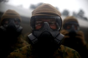 A U.S. Marine with Black Sea Rotational Force 17.1 dons his M50 gas mask prior to a company run aboard Adazi Military Base, Latvia, April 15, 2017. The Marines are in Latvia for Exercise Summer Shield, a multinational training evolution designed to train with NATO Allies in Europe. (U.S. Marine Corps photo by Cpl. Sean J. Berry)