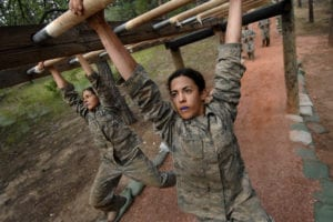 U.S. Air Force Academy, CO -- Basic Cadet Victoria Wyler attacks the monkey bars on the Jacks Valley Assault Course July 21. Basic cadet training started June 25 and continues through Aug. 1. The Class of 2013 will swear the Honor Oath at their Aug. 5 acceptance parade, when they earn their status as fourth-class cadets. The fall academic semester begins Aug. 6. U.S. Air Force Photo/Dennis Rogers