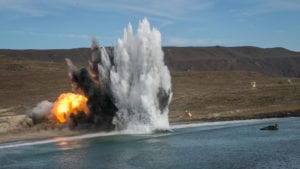 A U.S. Marine Corps amphibious assault vehicle with 1st Combat Engineer Battalion, 1st Marine Division, fires a mine clearing line charge during a simulated amphibious breach in support of exercise Steel Knight 2018 at San Clemente Island, Calif., Dec. 9, 2017. Steel Knight is a 1st Marine Division led exercise enabling Marines and Sailors to operate in a realistic environment developing necessary skill sets to maintain a fully capable Marine Air Ground Task Force. (U.S. Marine Corps photo by LCpl. Rhita Daniel)