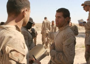 Sgt. Jesse R. Walden (right), a scout machine gunner with Company C, 3rd Light Armored Reconnaissance Battalion, gives Lance Cpl. Nathan J. Leibel (left), a point man with C Co., 3rd LAR Bn., tips on how to properly and confidently brief Marines during a training mission near Sahl Sinjar, Iraq, Aug. 5, 2009. The training was designed to give junior Marines leadership experience vital to the continuity of successful missions.