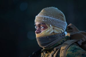 U.S. Marine Corps Lance Cpl. Kwan Walker, a networking administrator assigned to Marine Wing Communication Squadron 28, braces in the cold during a conditioning hike during exercise Ullr Shield at Fort McCoy, Wisconsin, Jan. 13, 2018. Ullr Shield is a training exercise designed to improve the 2nd Marine Aircraft Wing's capabilities in extreme cold weather environments. (U.S. Marine Corps photo by Lance Cpl. Cody Rowe)