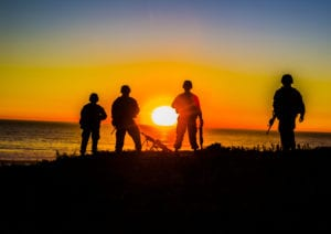 U.S. Marines with Combat Logistics Battalion 11, Headquarters Regiment, 1st Marine Logistics Group, overlook the beach during a field exercise at Camp Pendleton, Calif., Dec. 12, 2017. The Marines had continuous security to simulate a forward deployed environment. (U.S. Marine Corps photo by Lance Cpl. Adam Dublinske)