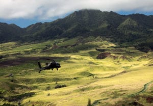 U.S. Army AH-64D Apache helicopter, assigned to the 25th Infantry Division, flies in formation for the 25th Infantry Division Review over Schofield Barracks, Hawaii, December 21, 2018. The Division's activation date is October 1, 1941. Due to a robust training schedule in October, the Division is celebrating its birthday from December 17-21 with the culminating event being the Division Review at historic Weyand Field. More than 11,000 Tropic Lightning Soldiers will take part in the Division Review. (U.S. Army photo by Staff Sgt. Ian Morales)