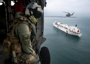 CALLAO, Peru (July 14, 2019) Naval Aircrewman (Helicopter) 1st Class Robert P. McCann, from New Freedom, Pa., flies in an MH-60S Sea Hawk helicopter alongside a Peruvian military Bell 412 over the hospital ship USNS Comfort (T-AH 20). Comfort is working with health and government partners in Central America, South America, and the Caribbean to provide care on the ship and at land-based medical sites, helping to relieve pressure on national medical systems strained by an increase in Venezuelan migrants. (U.S. Navy photo by Mass Communication Specialist 2nd Class Morgan K. Nall/Released)190714-N-IA905-1073