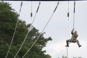 U.S. Army Staff Sgt. John Cauthon, Maneuver Center of Excellence drill instructor, climbs a rope on an obstacle course during the Drill Sergeant of the Year Competition August 19, 2019, at Joint Base San Antonio-Camp Bullis, Texas. Twelve Soldiers from around the United States travel to Texas to compete in the U.S. Army Drill Sergeant of the Year competition. For four days, competitors who have been selected to represent their training centers, must perform and master all associated Warrior tasks and drills from Basic Combat Training. To win, and be named the Drill Sergeant of the Year, they must not only be experts in training Soldiers, but also demonstrate that they are the best of the best and rise above the fierce competition. (U.S. Air Force photo by Sean M. Worrell)