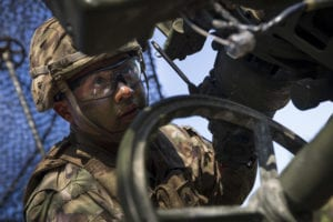 U.S. Army Sgt. Johnny Bonilla, a gunner and cannon crewmember assigned to Chaos Battery, 4th Battalion, 319th Airborne Field Artillery Regiment, 173rd Airborne Brigade, dials in a target of an M777 Howitzer during a live fire exercise as part of Saber Junction 19 (SJ19) at the 7th Army Training Command's Grafenwoehr Training Area, Germany, Sept. 11, 2019. SJ19 is an exercise involving nearly 5,400 participants from 16 ally and partner nations at the U.S. Army's Grafenwoehr and Hohenfels Training Areas, Sept. 3 to Sept. 30, 2019. SJ19 is designed to assess the readiness of the U.S. Army's 173rd Infantry Airborne Brigade to execute land operations in a joint, combined environment and to promote interoperability with participating allies and partner nations. (U.S. Army photo by Sgt. Thomas Mort)