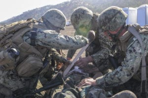 FORT HUNTER LIGGETT, Calif. (Nov. 8, 2019) Seabees assigned to Naval Mobile Construction Battalion (NMCB) 3 provide field medical care to a simulated casualty during a mass casualty drill as part of NMCB-3's field training exercise (FTX) at Fort Hunter Liggett, Calif. The battalion is conducting Operation Bearing Duel FTX that prepares and tests the battalion's ability to enter a hostile location, build assigned construction projects and defend against enemy attacks using realistic scenarios while being evaluated by Naval Construction Group 1. (U.S. Navy photo by Mass Communication Specialist 2nd Class Michael Lopez/Released) 191108-N-TP832-1061