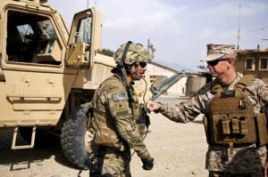 Marine Corps Gen. John R. Allen, commander of NATO and International Security Assistance Force troops in Afghanistan, gives a soldier assigned to Forward Operating Base Ghazni a thump on his body armor as he thanked him for his service and sacrifice. During Allen's battlefield circulation to Regional Command-East Aug. 15, he received several operational briefings, met with the Ghazni provincial governor and thanked U.S., Polish and Afghans for their commitment to the future of Afghanistan. ISAF is a key component of the international community's engagement in Afghanistan, assisting Afghan authorities in providing security and stability while creating the conditions for reconstruction development.