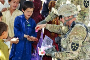 U.S. Army Command Sgt. Maj. Joseph Dallas, right, the command sergeant major of the 5th Battalion, 20th Infantry Regiment, 2nd Infantry Division, gives toys to Afghan children during Operation Southern Fist in Obezhan Kalay village, Spin Boldak district, Afghanistan, Sept. 30, 2012. The Afghan-led operation focused on denying the enemy freedom of movement and connecting area villagers with the Afghan government. (U.S. Army photo by Staff Sgt. Brendan Mackie/Released)