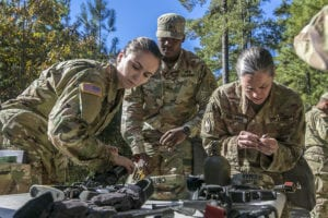 Candidates participating for the Expert Field Medical Badge disassemble and reassemble an M4 rifle as quickly as possible during the standardization phase of EFMB testing on Fort Bragg, N.C., Oct. 30, 2018. The first week of testing introduces the candidates to all the tasks that they'll be expected to complete to earn the coveted badge. The EFMB was established to showcase and recognize medical Soldiers for their exceptional skill level and competence in the medical field. The testing consists of a written exam, land navigation, three separate combat testing lanes and concludes with a 12-mile ruck march. (U.S. Army photo by Spc. Liem Huynh / 22nd Mobile Public Affairs Detachment)